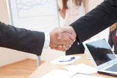Shake hands at office Royalty Free Stock Photos