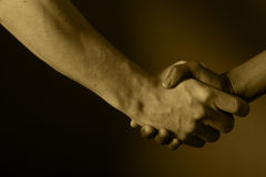 Shake hands. Shaking hands, agreeing, black and white Stock Image