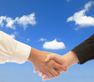 Shake hands with sky background Stock Photography