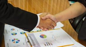 Shake hands to success Stock Photos