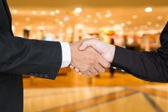 Shake hands to success Stock Images