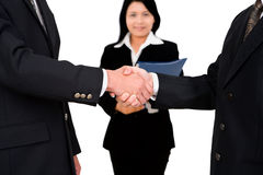 Shake hands with witness. Two business leader shake hand while a businesswoman witnessing it Stock Photography