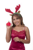Shake and listen. Christmas brunette reindeer and gift stocking Stock Photography