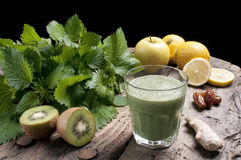 Shake nettles. With kiwi apples and ginger detox drink for a vegetarian diet stock photos