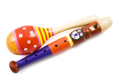 Shake rattle and roll. Colorful shaker with bear flute isolated over white Royalty Free Stock Photo