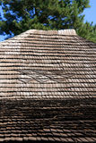 Shake roof. A shake is a wooden shingle that is made from split logs. When these are used for covering the top of a house, the result is a shake roof Stock Photos