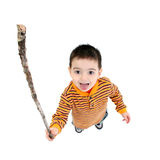 Shake A Stick At. Toddler boy, crazy face, shaking stick at camera. Shot in studio over white stock photography