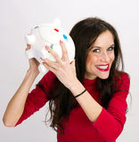 Shake it up Woman Checks Contents of Bank Royalty Free Stock Photos