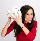 Shake it up Woman Checks Contents of Bank royalty free stock photos