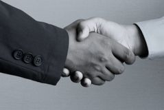 Shakehand. Business handshake in a plain background Royalty Free Stock Image