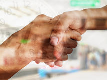 Shakehand on clock background. Done deal, successful contact Royalty Free Stock Photography