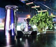 Shaker and bar inventory. Peppermint herb, shaker and bar inventory at a nightclub Royalty Free Stock Photography