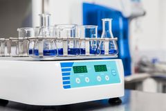 Shaker loaded with erlenmeyers and beakers. Laboratory shaker loaded with erlenmeyers and beakers Stock Image