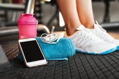 Shaker, towel, smartphone and earphones stock image