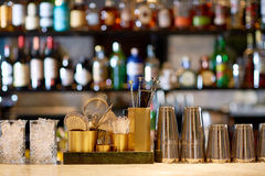 Shakers, glasses, stirrers and strainers at bar stock photography