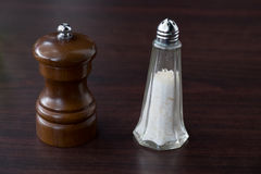 Shakers. Salt and pepper in wooden and glass Royalty Free Stock Photography