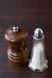 Shakers. Salt shaker and pepper grinder Royalty Free Stock Photo