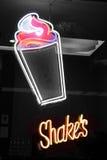 Shakes neon sign. Neon shakes signboard Stock Photos