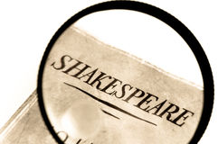 Shakespeare Book under Magnifying Glass Stock Image