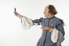 Shakespeare with cell phone. Royalty Free Stock Photo