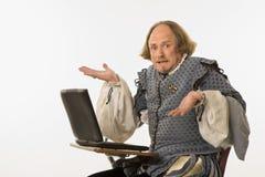 Shakespeare com computador. Imagens de Stock