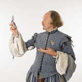 Shakespeare looking at phone. Royalty Free Stock Photo