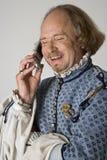 Shakespeare que fala no telefone. imagens de stock