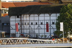 Shakespeare's globe theatre. A view of the Shakespeare's globe theatre taken from the north side of the River Thames Stock Photography