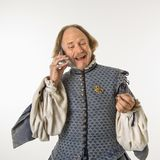 Shakespeare talking on phone. Royalty Free Stock Photography
