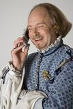Shakespeare talking on phone. Stock Images