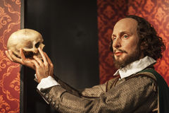 Shakespeare wax figure. Shakespeare with a skull in Madame Tussaud`s museum. Berlin, Germany Royalty Free Stock Photo