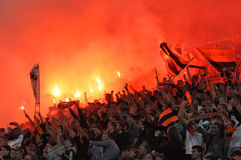 Shakhtar fans lit yellow fireworks in the stands Royalty Free Stock Photography