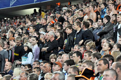 Shakhtar fans sitting and standing watch the game Royalty Free Stock Image