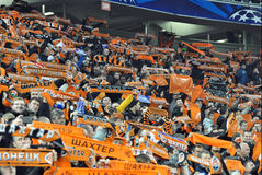 Shakhtar fans in the stands raised scarves Royalty Free Stock Images