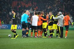 Shakhtar footballers and Borussia Dortmund at the end of the match Royalty Free Stock Image
