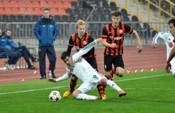 Shakhtar player knocks his opponent to the ground Royalty Free Stock Image