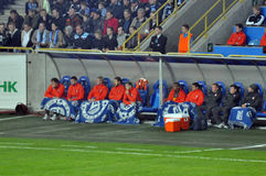 Shakhtar players hiding blankets with symbols of the team Dnepr Stock Photography