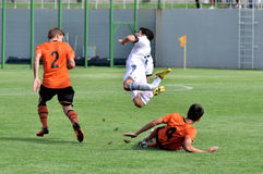 Shakhtar players knock other team player Stock Images