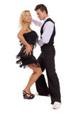 Shaking. Beautiful couple dancing latino, isolated over white Stock Photos