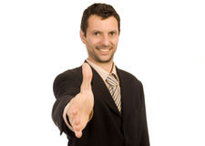 Shaking. Young man shaking hand white isolate Royalty Free Stock Image