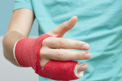 Shaking Bandaged Hand Stock Image