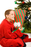 Shaking the Christmas Gift Royalty Free Stock Photos
