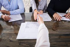 Shaking Hand With Corporate Recruitment Officers. Close-up Of An Applicant Shaking Hand With Corporate Recruitment Officers In Office stock photography