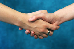 Shaking hands. From two woman. only arms and hands are seen Stock Image