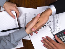 Shaking hands. Businessman and business woman sign contract and shaking hands royalty free stock images