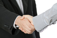 Shaking hands. Businessman and businesswoman shaking hands after signing contract stock photography