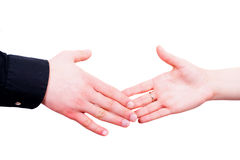 Shaking hands. Man and woman shaking hands to have a deal Royalty Free Stock Photography