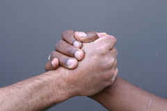 Shaking hands. A black man and white man shaking hands Royalty Free Stock Photos