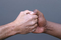 Shaking hands. A black man and white man shaking hands Stock Images
