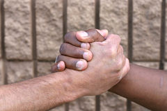Shaking hands. A black man and white man shaking hands Stock Photo